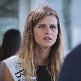 Lead character wearing a tiara and looking upset
